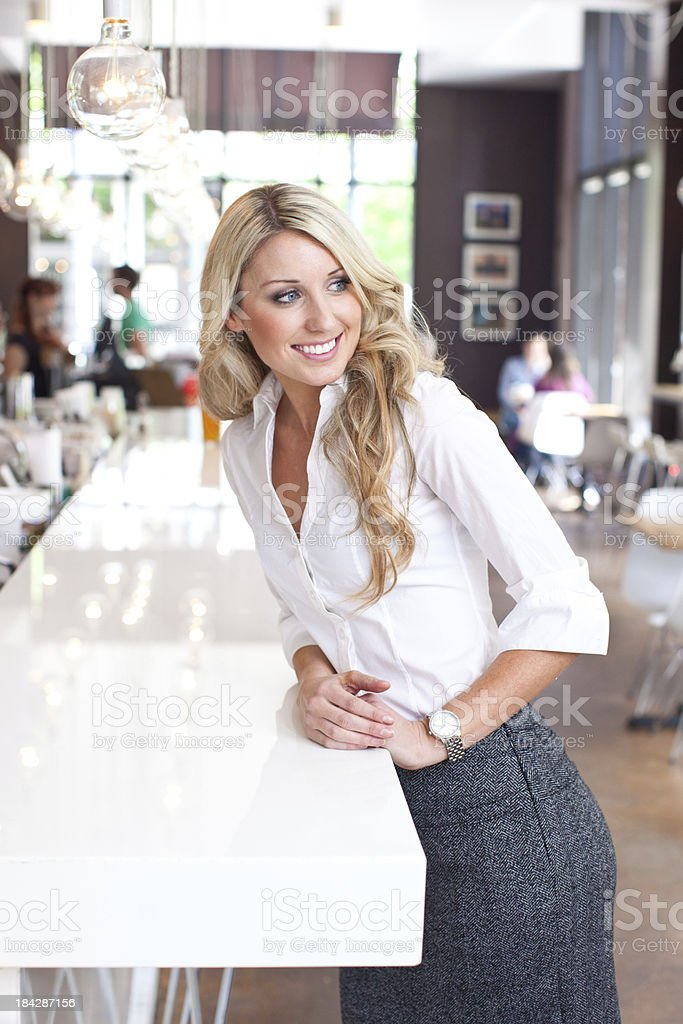 Beautiful young blonde woman in a cafe downtown stock photo