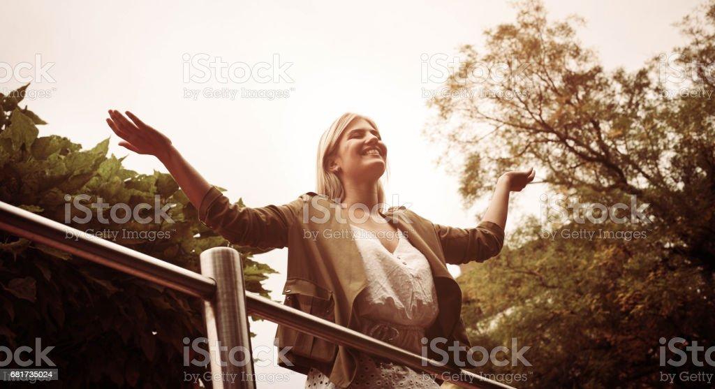 Beautiful young blonde woman outdoors. stock photo