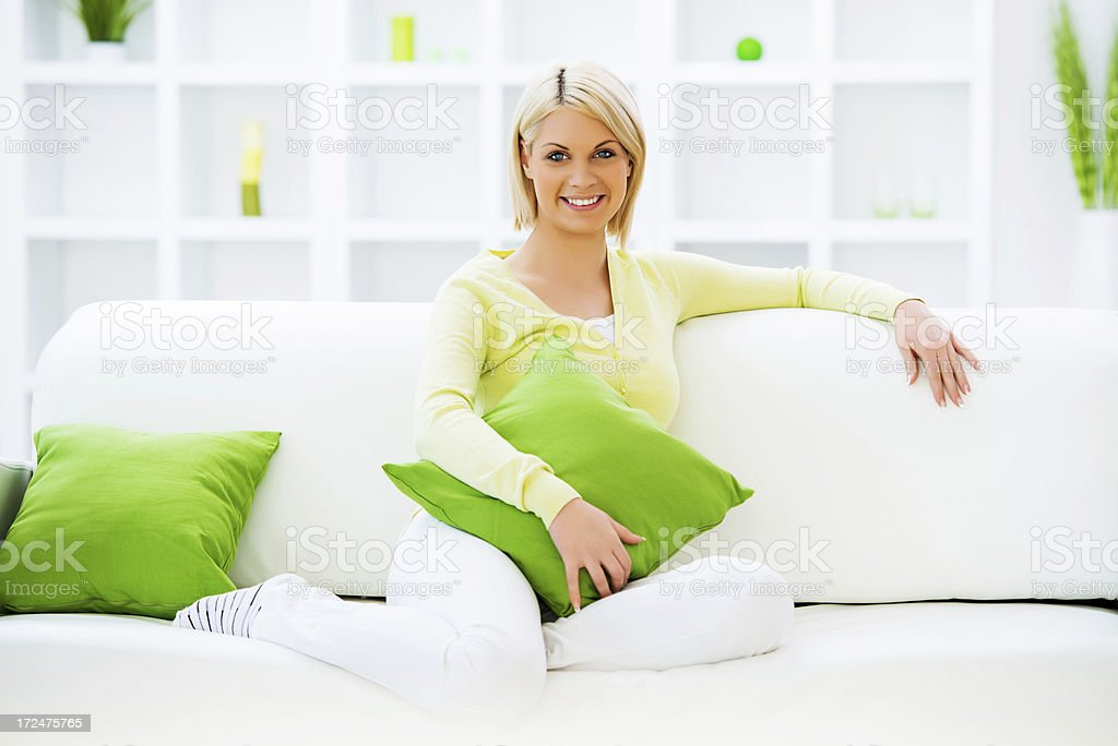 Beautiful young blonde woman relaxing at home. royalty-free stock photo