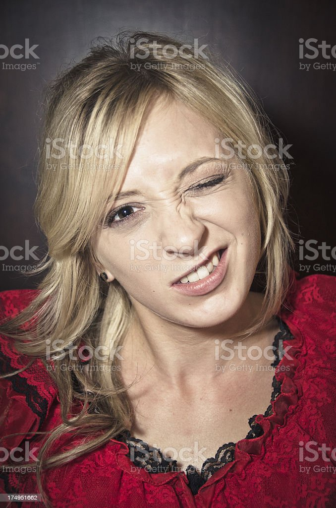 Beautiful Young Blonde Woman Winking royalty-free stock photo