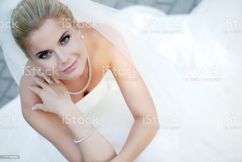 Beautiful young bride wearing wedding dress royalty-free stock photo
