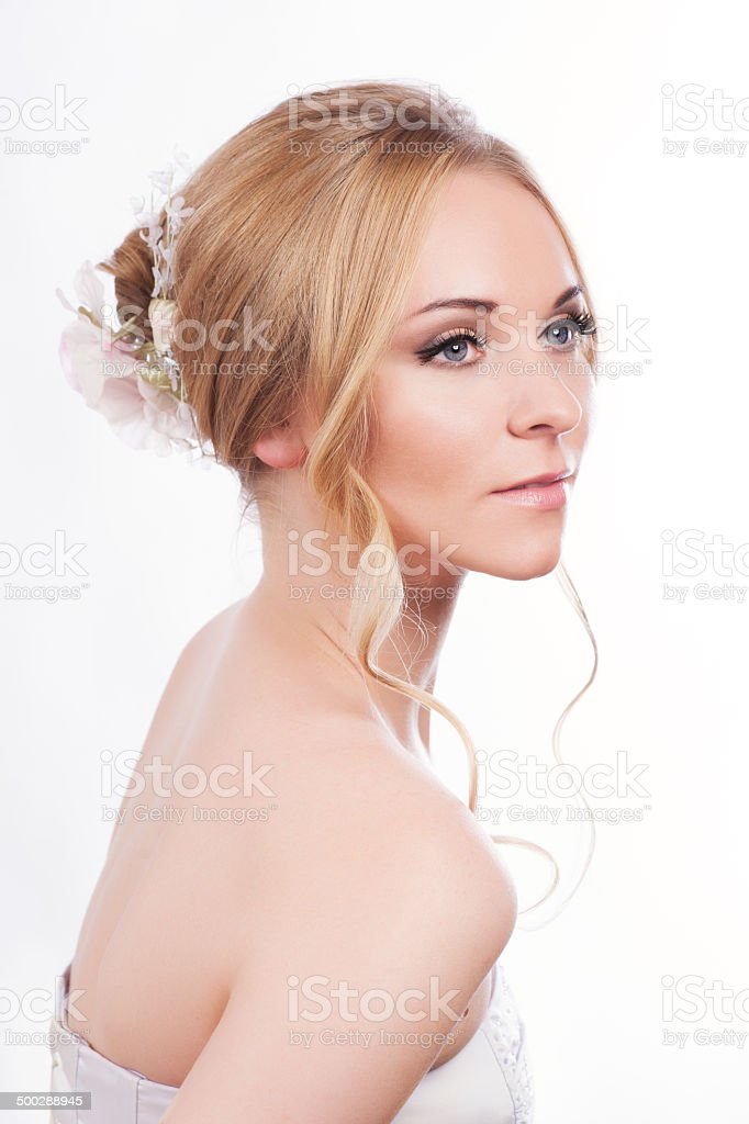 Beautiful young bride with pink make-up and ringlet wedding hairstyle stock photo