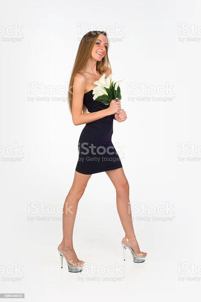 Beautiful Young Bridesmaid Wearing Black Short Dress Holding Bridal Bouquet royalty-free stock photo