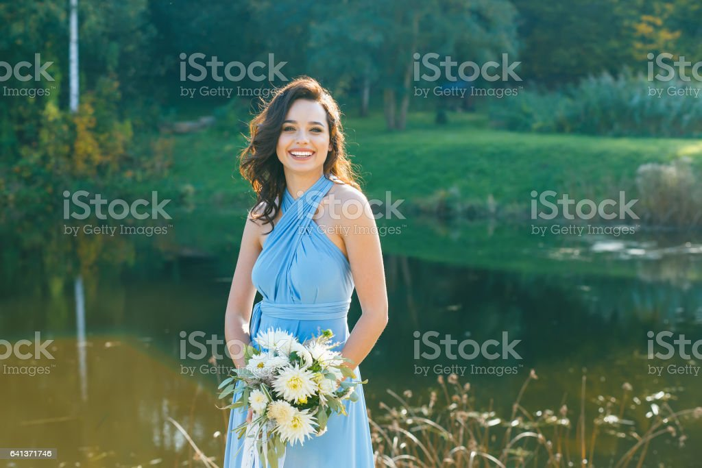 Beautiful young bridesmaid with curly hair stock photo