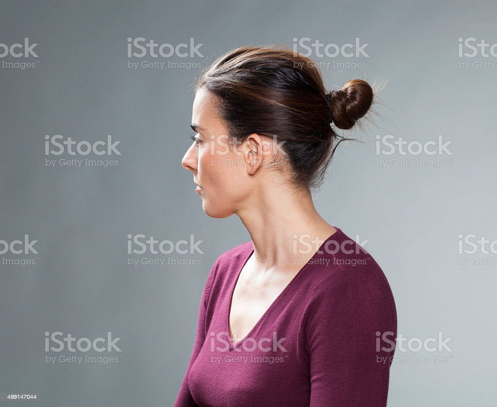 beautiful young brunette thinking about her past in looking back stock photo