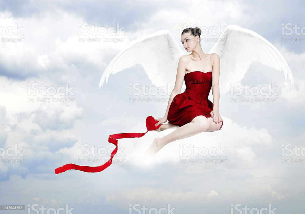Beautiful young brunette woman as love angel royalty-free stock photo