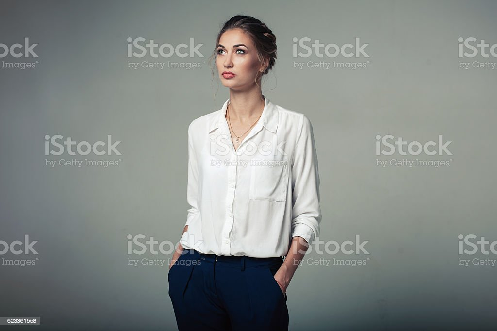 Beautiful young buisness woman in studio stock photo