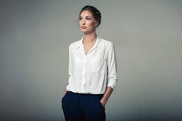 Beautiful young buisness woman in studio stock photo