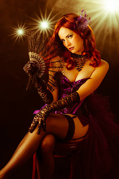 beautiful young burlesque showgirl on stage - burlesque stock photos and pictures