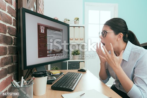 istock beautiful young business woman feeling surprised 847207590