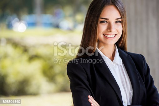 istock Beautiful young business woman, smiling, close up portrait. With copy space. 856301440