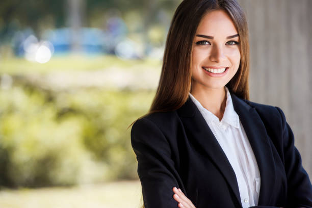 beautiful young business woman, smiling, close up portrait. with copy space. - woman suit stock photos and pictures