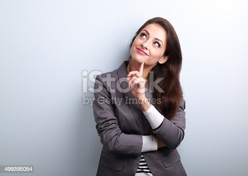 istock Beautiful young business woman thinking and looking up 499395054