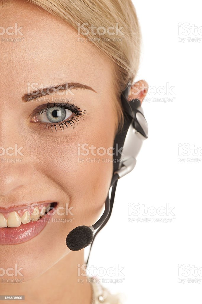 Beautiful young business woman with headset royalty-free stock photo