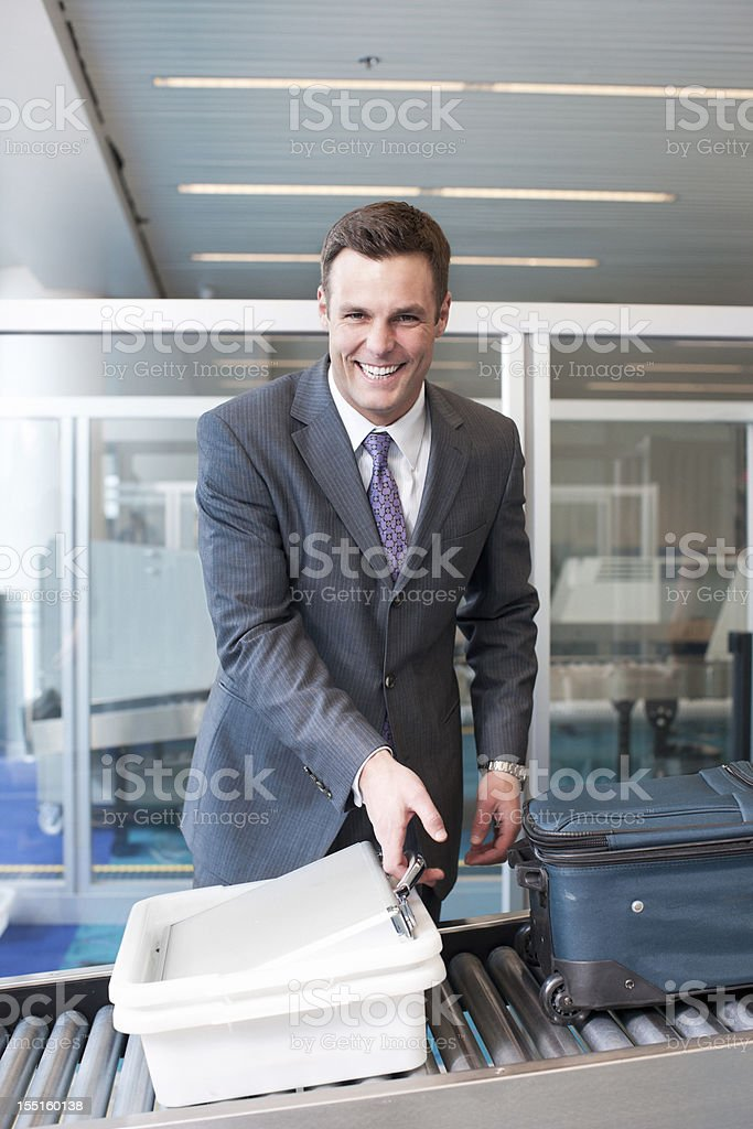 Beautiful Young Businessman Smiling at Airport Security stock photo