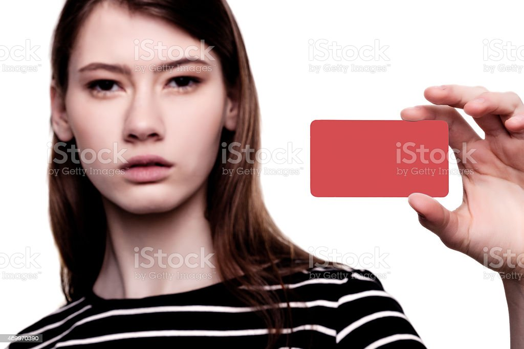 Beautiful Young Businesswoman Holding Business Card stock photo
