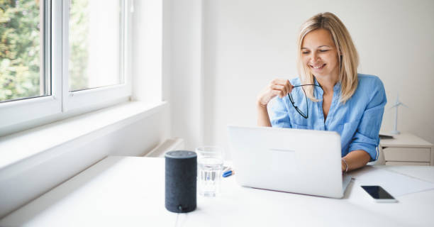 beautiful young businesswoman in blue shirt is working in her office stock photo