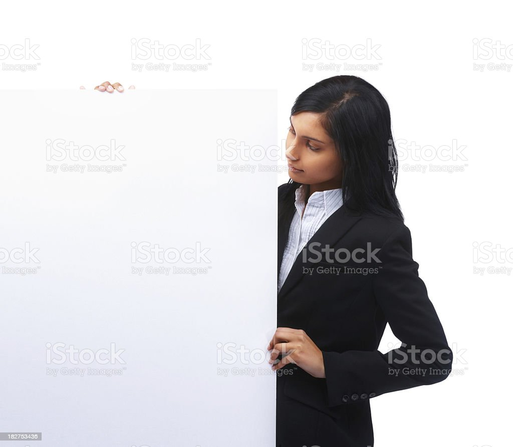 Beautiful young businesswoman looking at blank billboard royalty-free stock photo