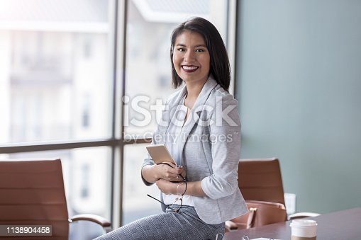 1150572102istockphoto Beautiful young businesswoman 1138904458