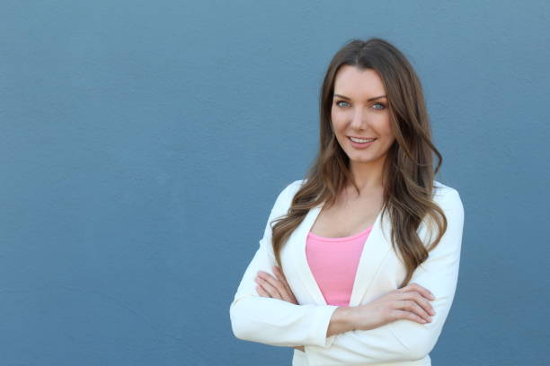 beautiful young businesswoman smiling with arms crossed - pinky promise stock photos and pictures