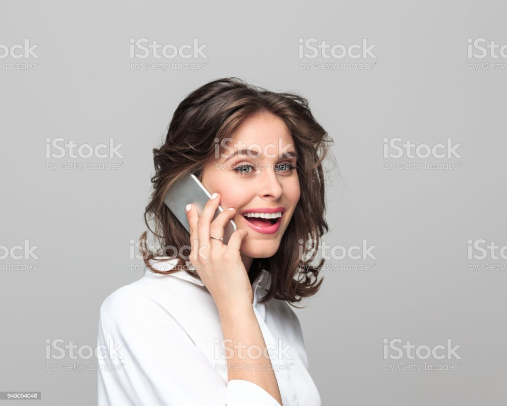 Beautiful young businesswoman talking on smart phone - Royalty-free 25-29 Years Stock Photo