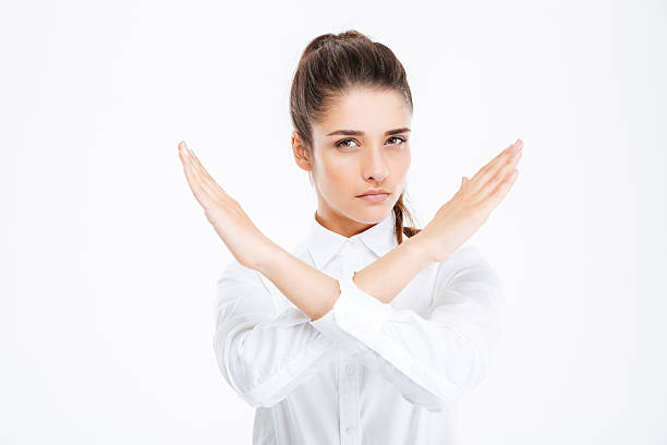 Beautiful young businesswoman with crossed hands showing stop gesture – Foto