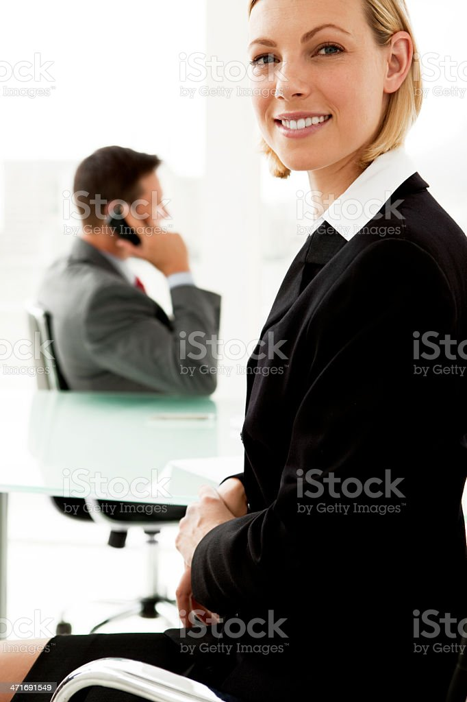 Beautiful young businesswoman with partner on the phone royalty-free stock photo