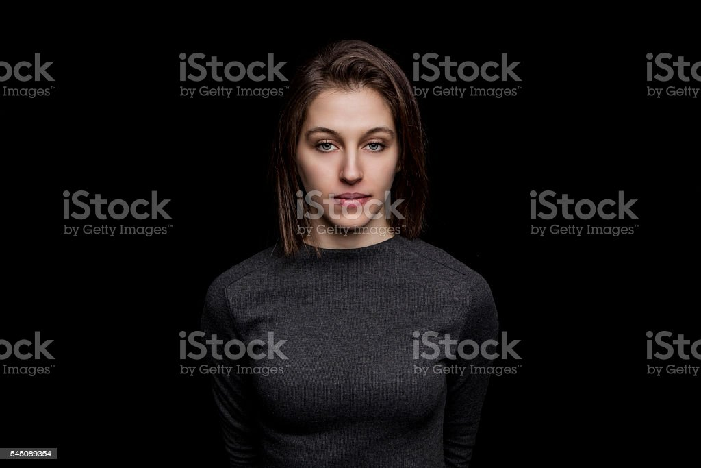beautiful young caucasian woman portrait on black background stock photo