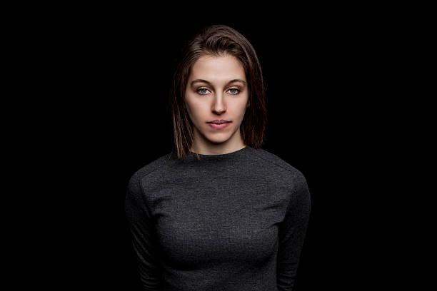beautiful young caucasian woman portrait on black background stock photo