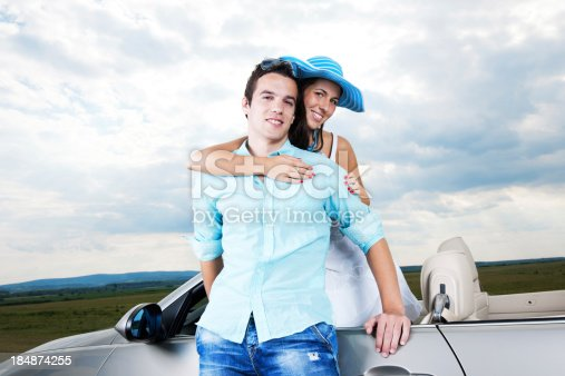 481388538 istock photo Beautiful young couple and Convertible car. 184874255