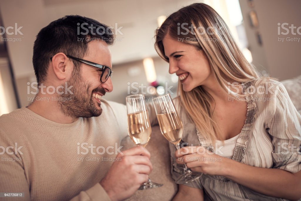Beautiful young couple at home stock photo
