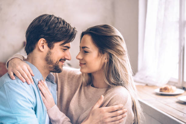 beautiful young couple embtacing eachother home young woman, bearded man, home, relax, lovers, embracing, love, face to face stock pictures, royalty-free photos & images