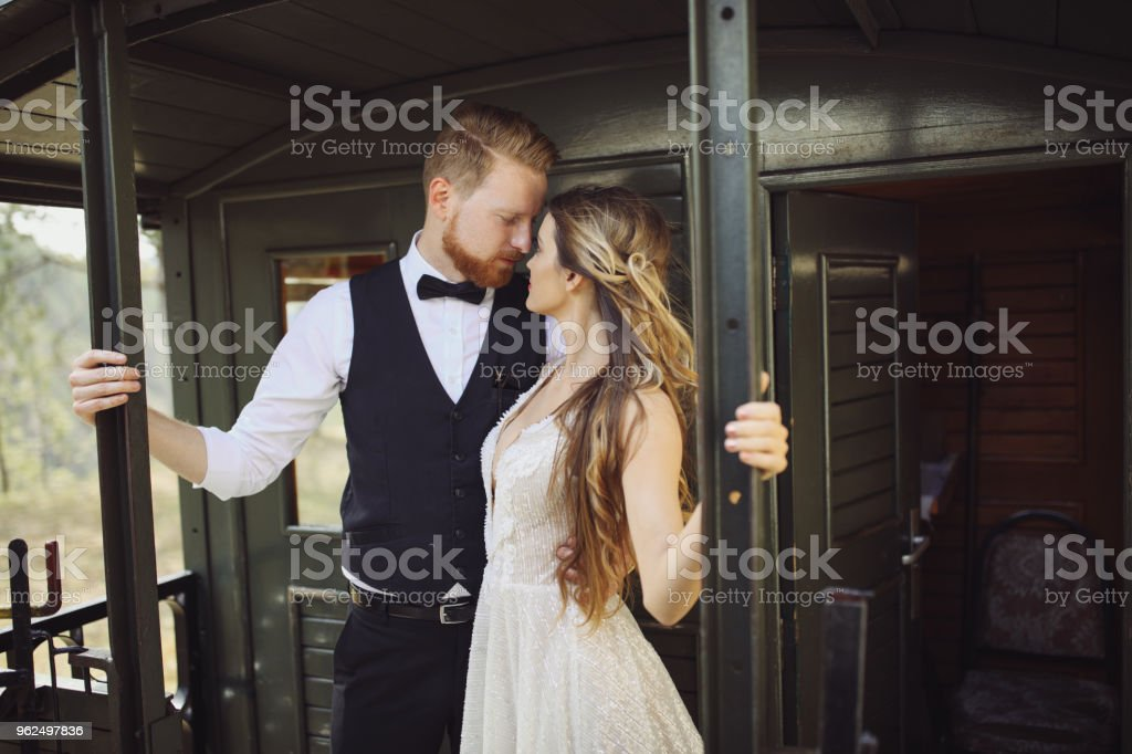 Beautiful young couple enjoying the journey by train - Royalty-free 20-29 Years Stock Photo