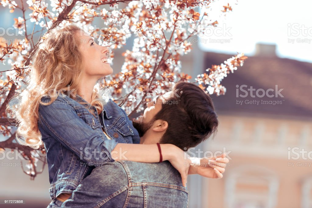 Beautiful young couple enjoying together stock photo