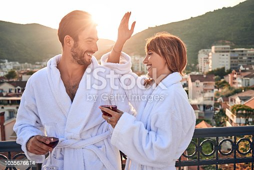 romantic couple enjoying together and having a glass of wine