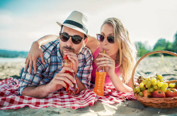 Beautiful young couple having fun on the beach. Lifestyle, love, dating, vacation concept stock photo