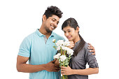 istock Beautiful young couple holding bunch of white flowers 925079820