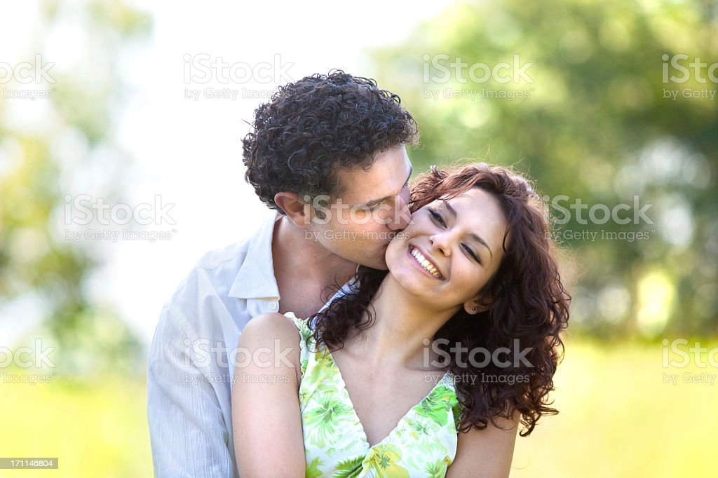 A beautiful, young couple hugging and kissing royalty-free stock photo