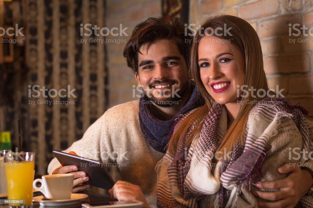 Beautiful young couple in cafe. royalty-free stock photo