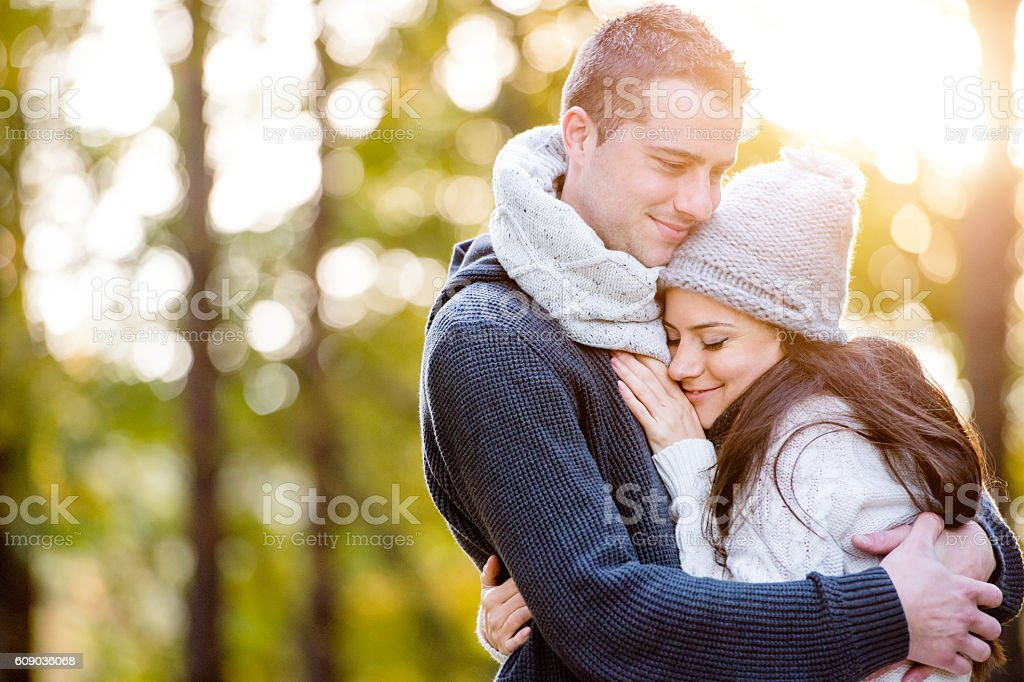 Beautiful young couple in love, hugging. Sunny autumn nature. stock photo