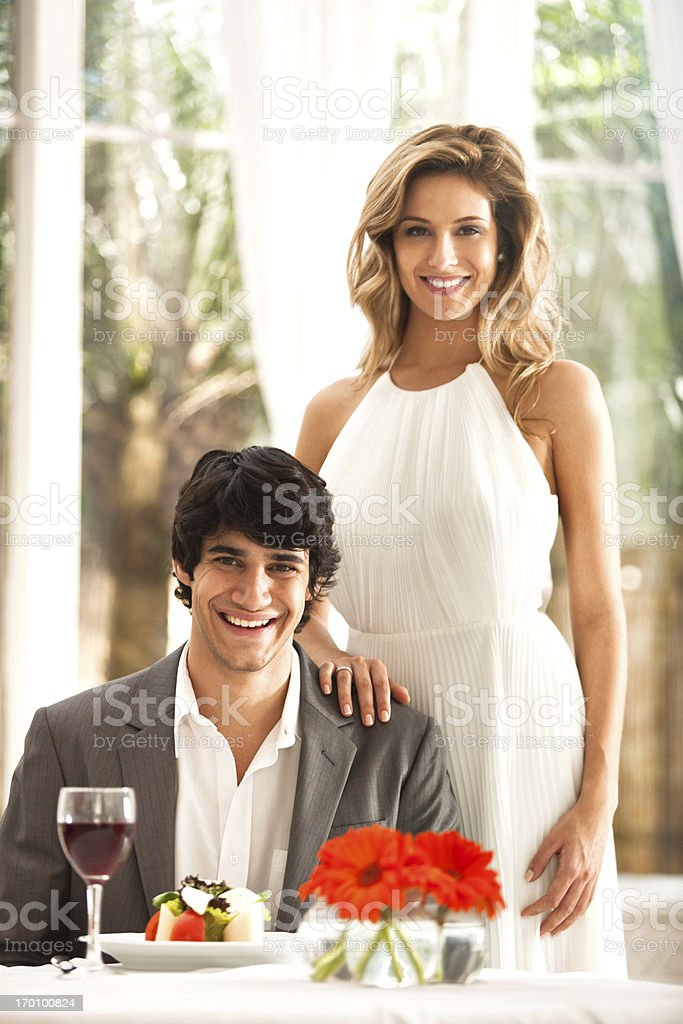 Beautiful young couple in the restaurant. royalty-free stock photo