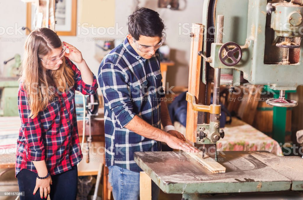 Beautiful young couple  in their studio - crafts - people stock photo