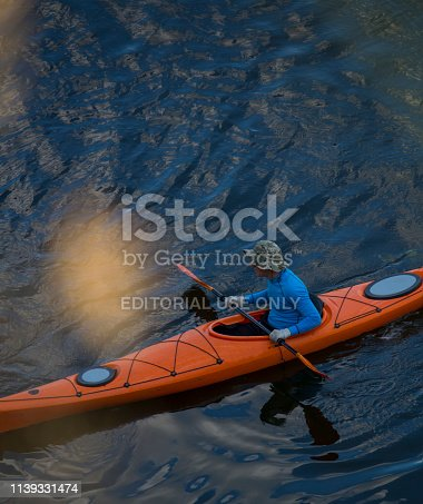 istock Beautiful young couple kayaking on river together and smiling 1139331474