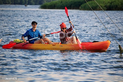 istock Beautiful young couple kayaking on river together and smiling 1139331475
