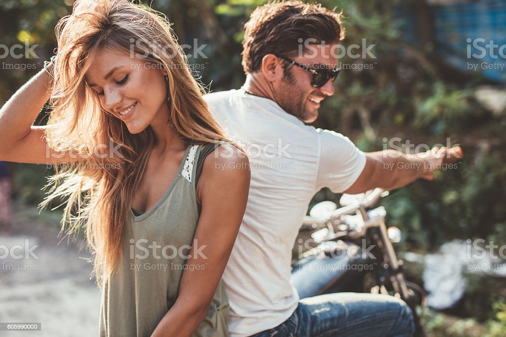 Beautiful young couple on a motorcycle stock photo