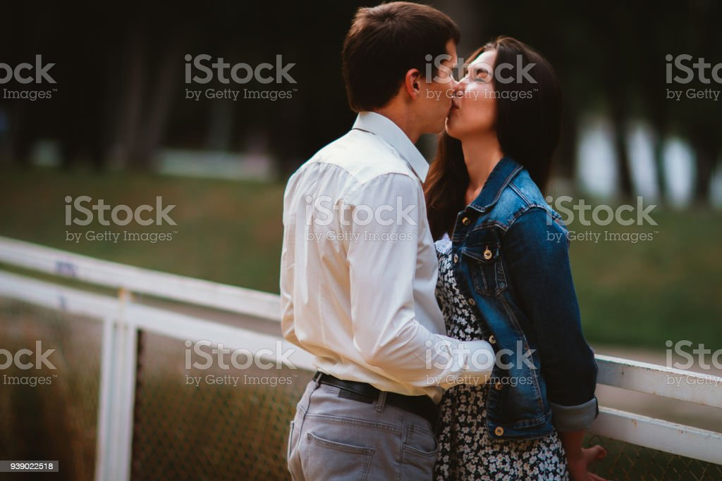 Beautiful young couple on the waterfront stock photo