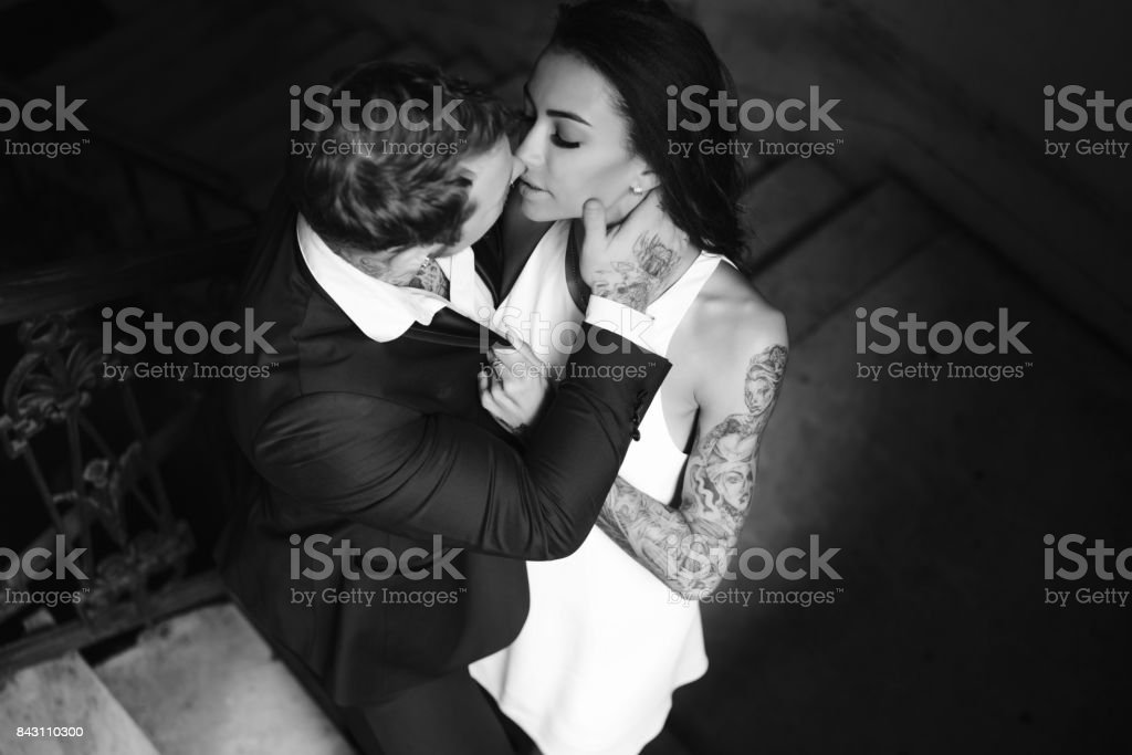 Beautiful, young couple posing on camera indoors stock photo
