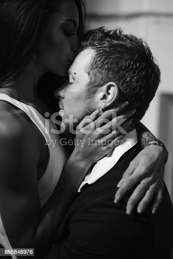 istock Beautiful, young couple posing on camera indoors 865846976