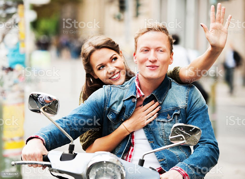 Beautiful young couple riding on a motorbike. royalty-free stock photo