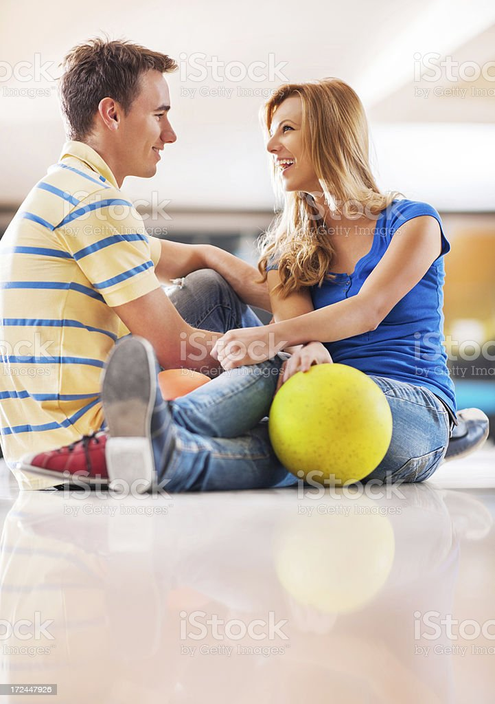 Beautiful young couple sitting at bowling alley. royalty-free stock photo